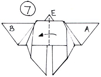 An illustration of the valley fold made down the midline of the butterfly